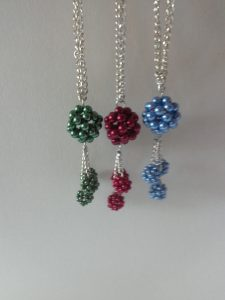 Green, wine-red, blue necklaces